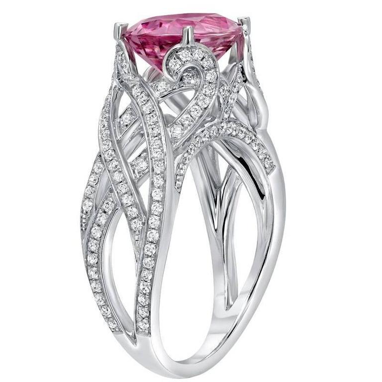 An exquisite, hard to find, 3.18ct oval flawless Pink Spinel, set in a 0.53ct diamond thread-like ring. Hand crafted in 18K white gold. Size 6. Re-sizing is complimentary upon request.  ***Returns are accepted within 7 days of delivery and will