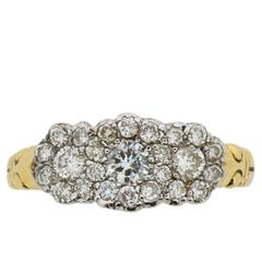 0.62 Carat Round Brilliant Cut Diamond Yellow Gold Cluster Ring, circa 1950s