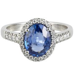 Oval Ceylon Sapphire Diamond Platinum Cluster Engagement Ring