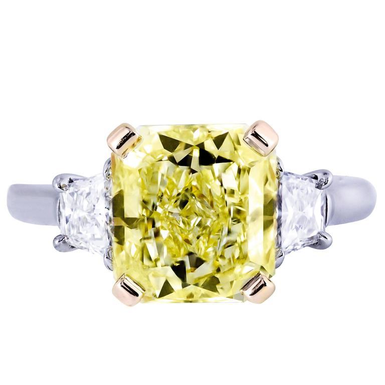 4.01 Carat GIA Certified Fancy Yellow Diamond Three-Stone Engagement Ring