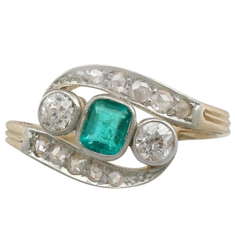 1920s Emerald and Diamond Yellow Gold Twist Ring