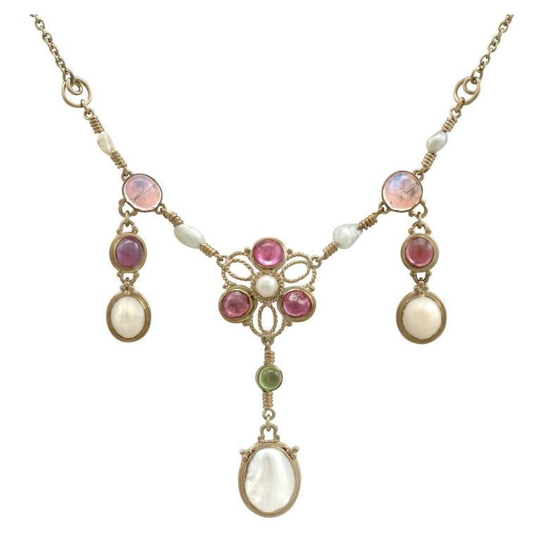 1920s Pearl and 3.32 Carat Moonstone Peridot and Amethyst Yellow Gold Necklace