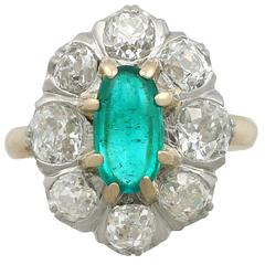 1920s Antique 1.50 Carat Emerald and 2.85 Carat Diamond Yellow Gold Cluster Ring