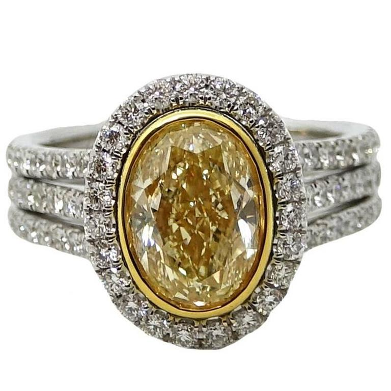 3.01 Carat Yellow Oval Cut Diamond Platinum Engagement Ring