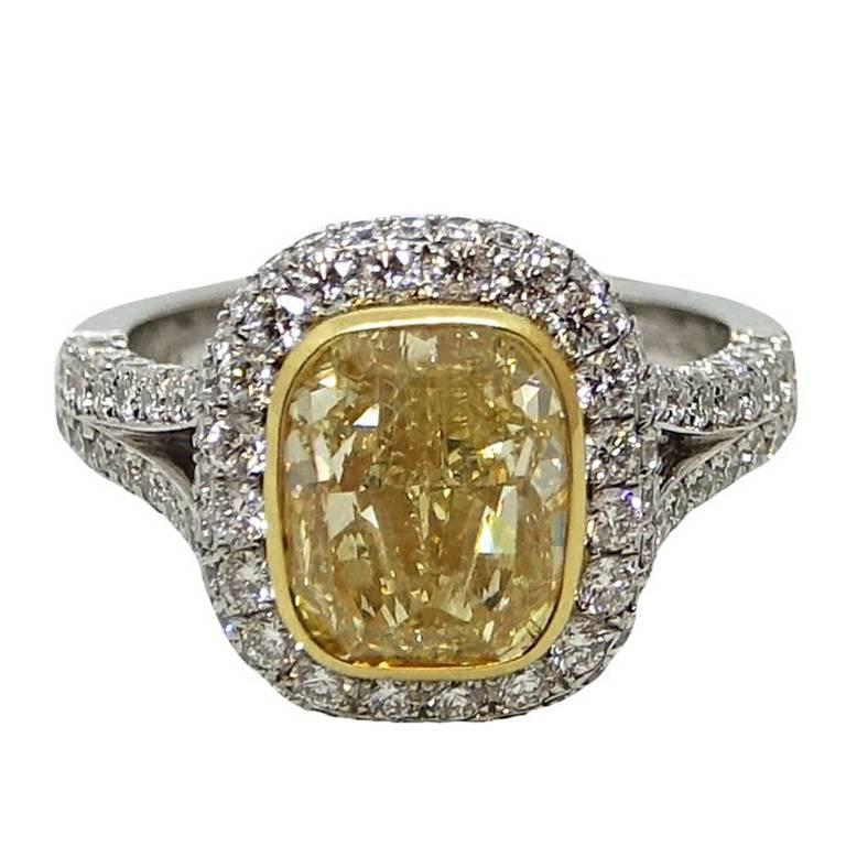 4 00 Carat Fancy Yellow Cushion Cut Diamond Platinum and Gold Ring For Sale a