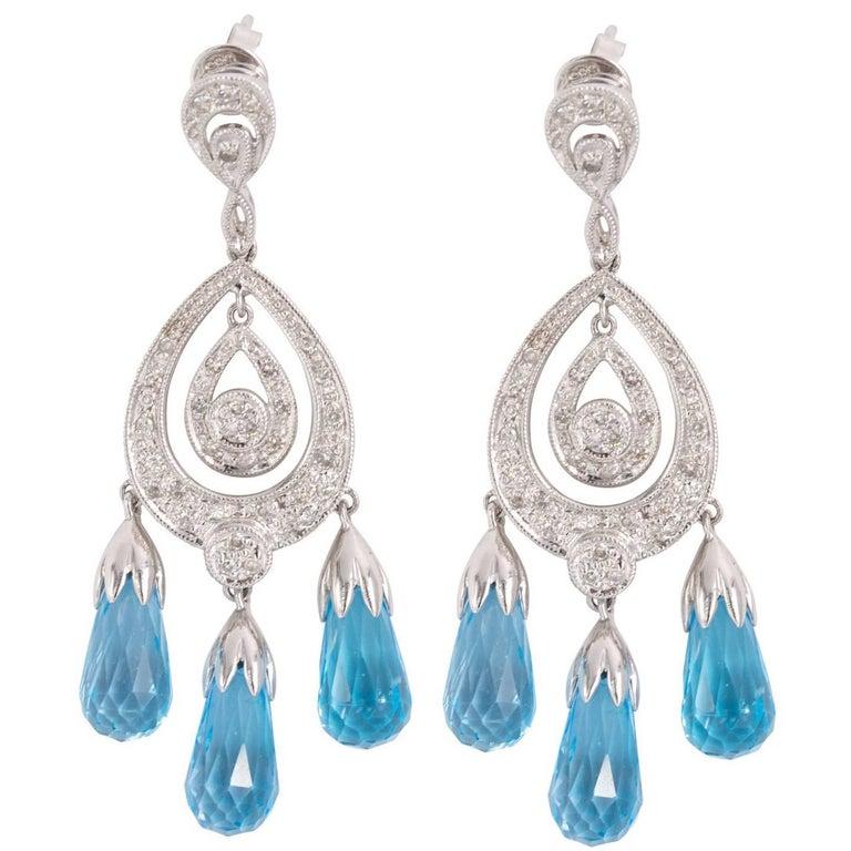 Diamond onyx deco style swaying chandelier earrings for sale at 1stdibs art deco style blue topaz chandelier earrings aloadofball Image collections