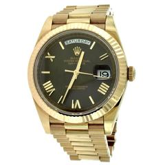 Rolex Day-Date 40 Everose Gold Chocolate Roman Numeral President Watch 228235