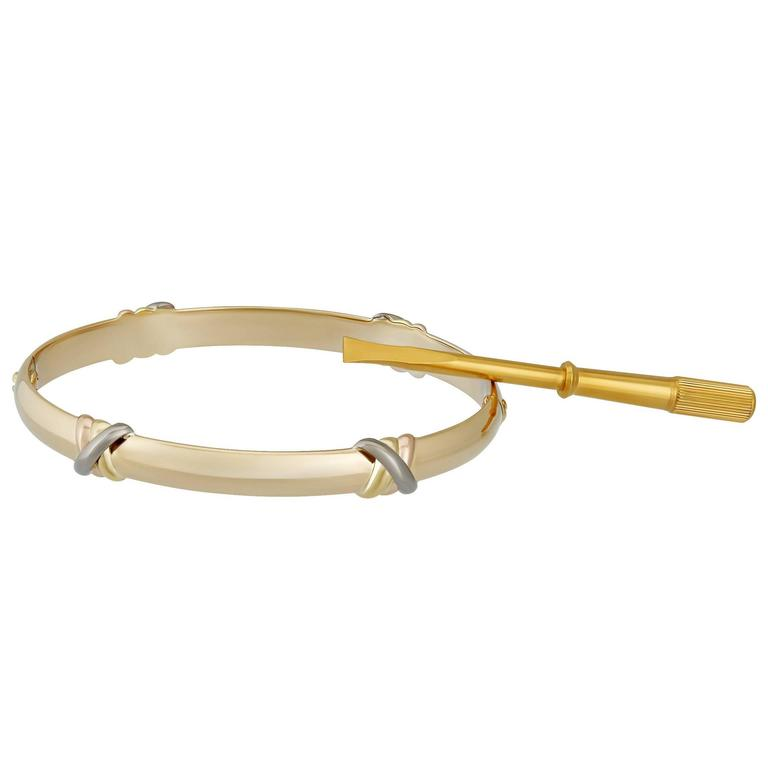 Cartier 18K Yellow and White Love Trinity Bangle Size: 17 For Sale