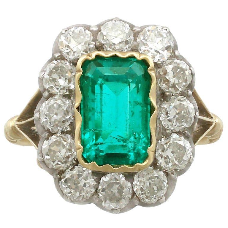 1890s 2 Carat Colombian Emerald and 2.2 Carat Diamond Yellow Gold Cocktail Ring