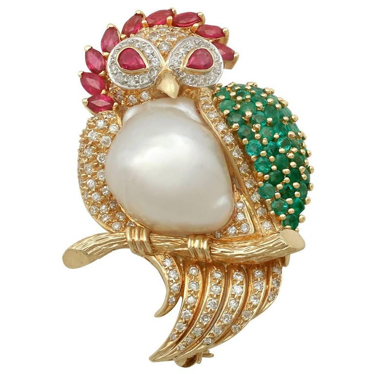 1980s Pearl 1.76 Carat Ruby 1.30 Carat Emerald & 1.15 Carat Diamond Gold Brooch For Sale