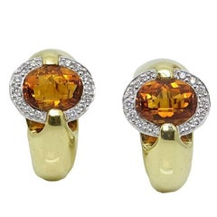 Diamond and Topaz Omega Back Yellow Gold Earrings