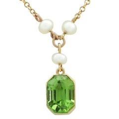1900s 3.16 Carat Peridot and Seed Pearl 15 Karat Yellow Gold Pendant
