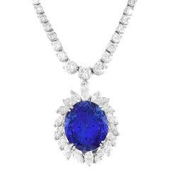 23.00 Carat Tanzanite and Diamond Halo Pendant in Gold
