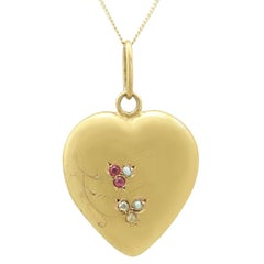 1900s Diamond and Ruby, Seed Pearl Yellow Gold Heart Pendant