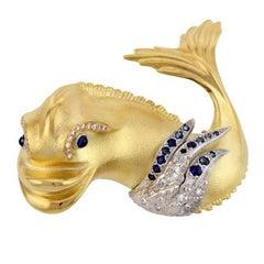 Diamond and Sapphire 18k Gold Renaissance Dolphin Brooch by John Landrum Bryant