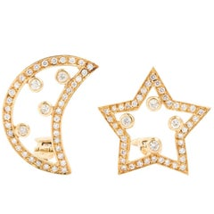 Pair of 18 Karat Diamond Moon and Star Earrings