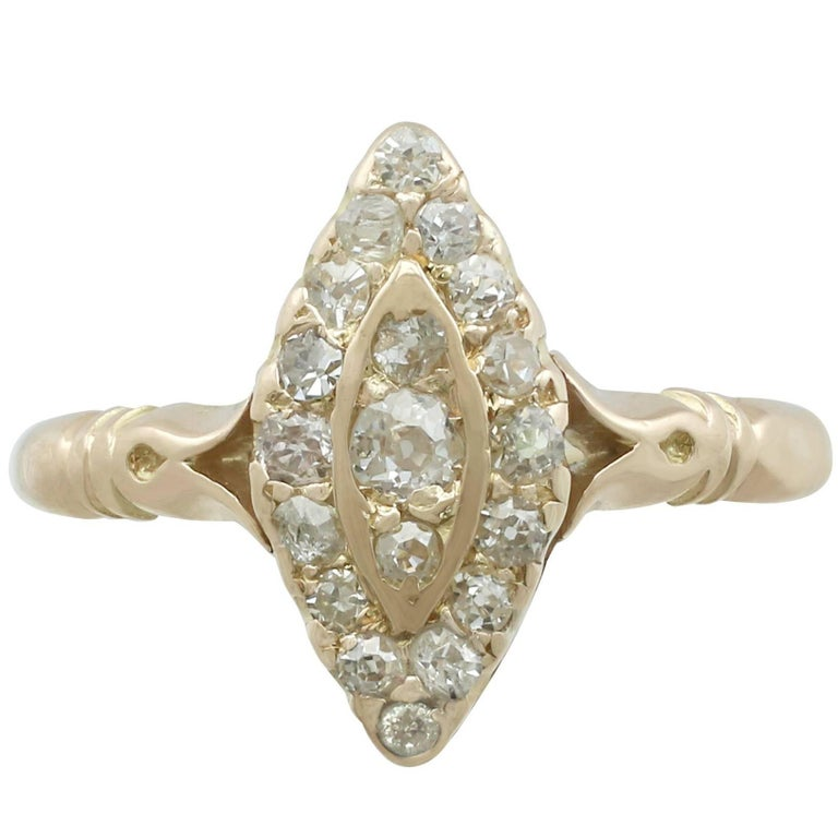 1910s Diamond and 14 Karat Yellow Gold Marquise Ring