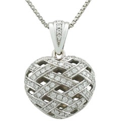 1980s Diamond and 18 Karat White Gold Heart Pendant