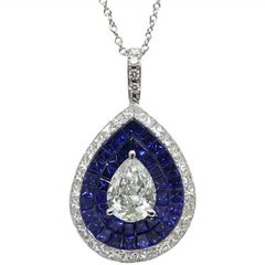 1.01 Carat Pear Shaped Center Diamond and Sapphire Stadium White Gold Pendant
