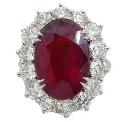 GIA Certified 10.18 Carat Vibrant Oval Cut Ruby and Diamond Platinum Ring
