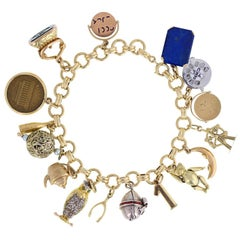 Vintage Gold Charm Bracelet with 16 Various Charms