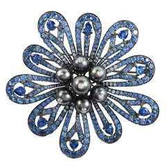 SAM.SAAB Sapphire and White Diamond Flower Motif Brooch