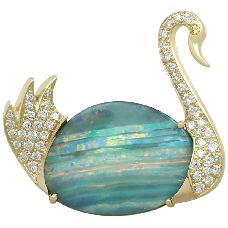 1980s 13.79 Carat Opal 1.15 Carat Diamond 18 Karat Yellow Gold 'Swan' Brooch