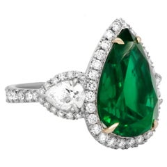 GIA Certified 8.78 Carat Green Emerald Pear Shaped Platinum Ring with Diamonds