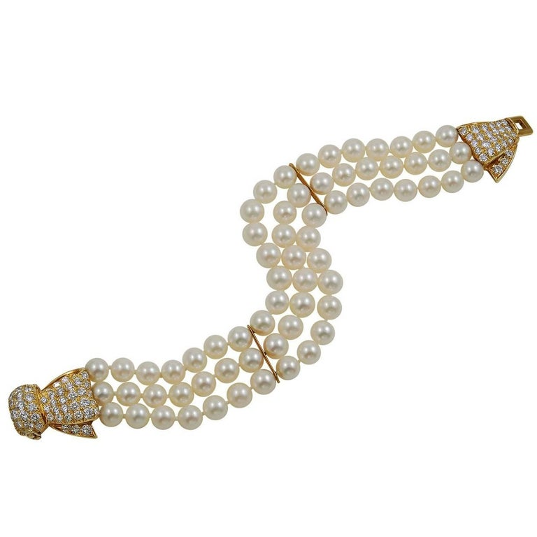 Van Cleef & Arpels Diamond and Three-Row Pearl Bow Bracelet