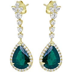 7.06 Carat Emerald Diamond Halo Dangling Gold Earring