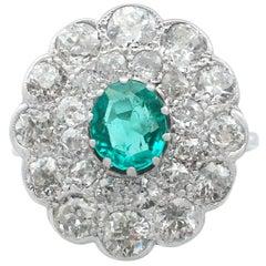 1930s Emerald and 2.40 Carat Diamond Platinum Cluster Ring