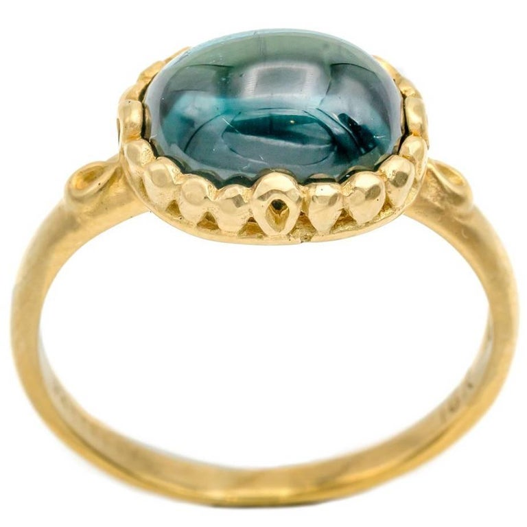 Oval Deep Sea Blue Tourmaline Ring in 18 Karat Yellow Gold with Satin Finish