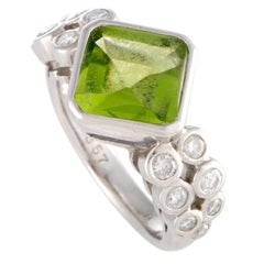 Diamond and Peridot Solitaire Platinum Ring