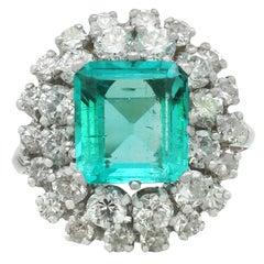 1950s 2.42 Carat Emerald 1.62 Carat Diamond White Gold Cluster Ring