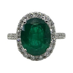 5.20 Carat Oval Cut Emerald and Diamond White Gold Engagement Ring