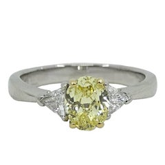 Oval Brilliant Fancy Intense Yellow Diamond Platinum Engagement Ring