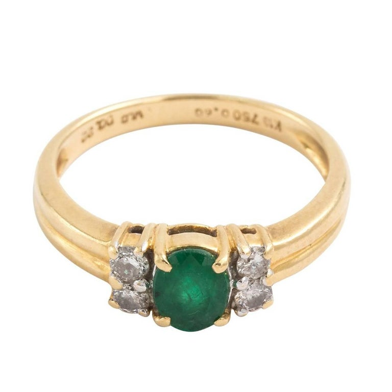 18KT Emerald and Four Diamond Ring