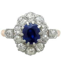1910s 1.18 Carat Sapphire and Diamond 18 Karat Yellow Gold Cluster Ring