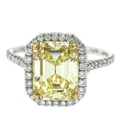 GIA 2.51 Carat Emerald Cut Fancy Yellow Diamond Halo Ring in Platinum