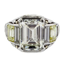 5.01 Carat Emerald Cut Diamond and Fancy Yellow Diamond Platinum and Gold Ring