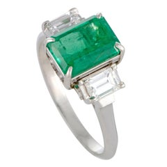 Diamond and Emerald Three-Stone Platinum Ring
