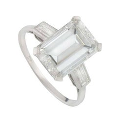 GIA Certified Emerald Cut Three Stone Diamond Engagement Ring 7.02 Ct H/VS1