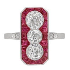 Art Deco Diamond and Ruby Three-Stone Halo Ring, circa 1920s