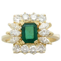 1980s Emerald and 1.32 Carat Diamond 18 Karat Yellow Gold Dress Ring