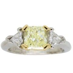 Certified Fancy Yellow Three-Stone Diamond Ring in Platinum and 18 Karat Gold