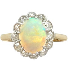 1920s 1.18 Carat Opal Diamond 18 Karat Yellow Gold Cluster Ring
