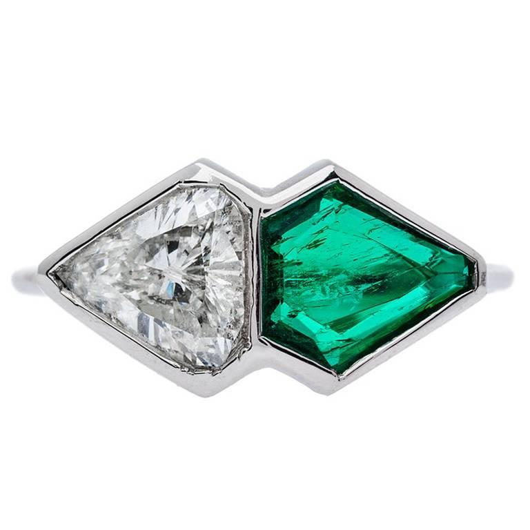 1.08 Carat Shield Cut Diamond 0.84 Carat Emerald Platinum Two-Stone Ring