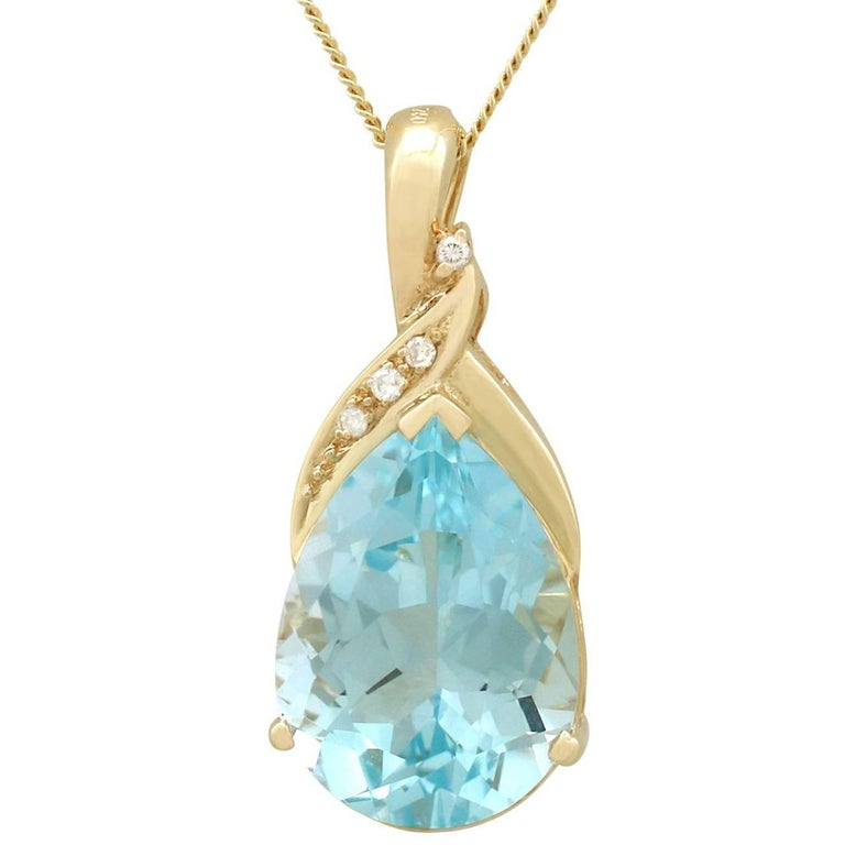 1990s 11.98 Carat Topaz and Diamond, Yellow Gold Pendant