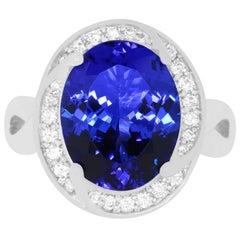 6.31 Carat Oval Shaped Tanzanite and 0.31 Carat White Diamond Ring