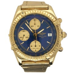 Brietling Yellow Gold Blue Dial Chronomat Wristwatch
